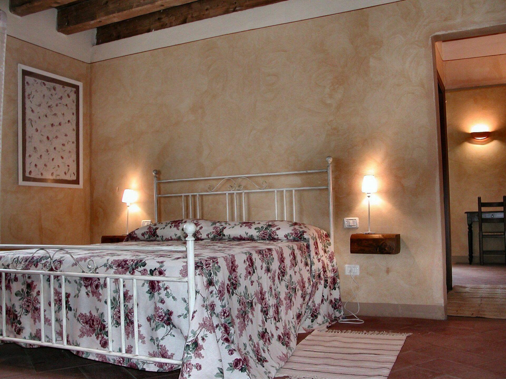 Fattoria di romignano villa vacanza a traiana toscana for Camere da letto b b italia